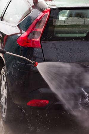 Washing the car at the carwash photo
