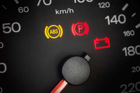 traction engine: ABS light. Car dashboard in closeup