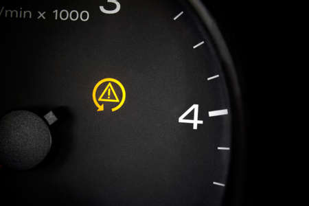 Traction control light. Car dashboard in closeup