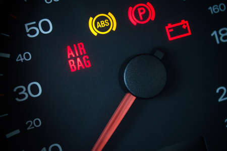 car service: Airbag warning light. Car dashboard in closeup