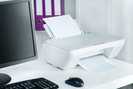 office printer: Composition of white printer and black computer in modern office Stock Photo