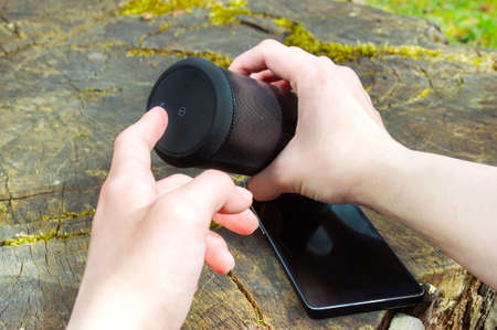 wireless connection: Wireless connection of speaker and smartphone in outdoor entertainment. Stock Photo