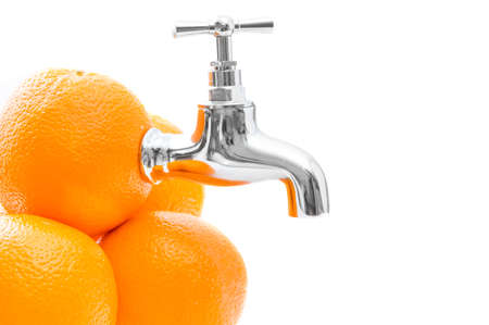 orange juice: Conception of oranges with metal tap on white background