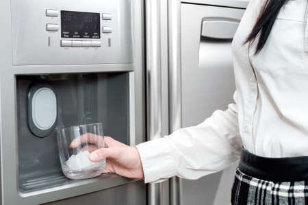 purifying: Refrigerator is making fresh clean ice cubes.