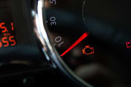 Check engine light. Car dashboard in closeup Standard-Bild