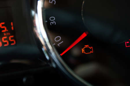 Check engine light. Car dashboard in closeup Stockfoto