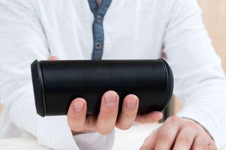 bluetooth: Man shows Modern wireless audio device.
