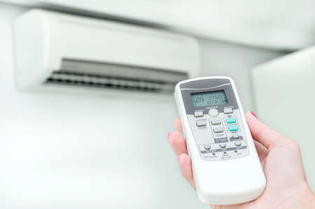 mode: Setting air conditiong mode on. Stock Photo