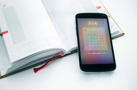electronic organiser: Modern smartphone calendar for 2016. Concept for business devices Stock Photo
