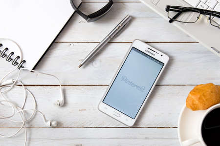 samsung: WROCLAW, POLAND- OCTOBER 18th, 2016 : Samsung A5 with Instagram application laying on desk. Pinterest is a web and mobile application company that operates a photo sharing website. Editorial