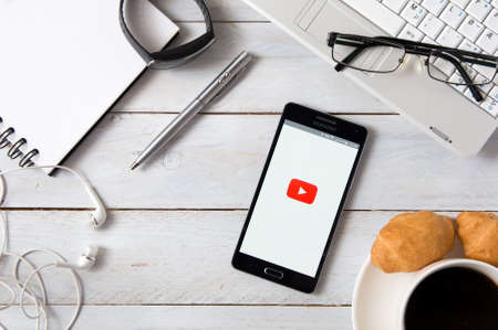 samsung: WROCLAW, POLAND- OCTOBER 18th, 2016 : Samsung A5 with YouTube application laying on desk. YouTube allows users to upload, view, rate, share, and comment on videos