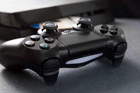 playstation: WROCLAW, POLAND -  NOVEMBER 30th, 2016: DualShock 4 on desk. The DualShock 4 is the PlayStation 4s controller. Editorial