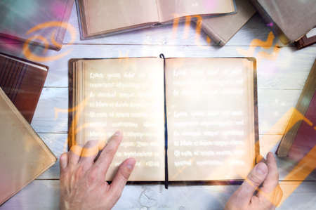 the place is important: Old book with empty pages for your text and mans hand shows important place.