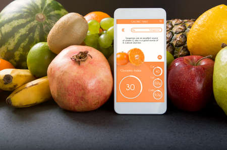 glycemic: Smartphone with app showing the glycemic index. Concept of app for healthcare