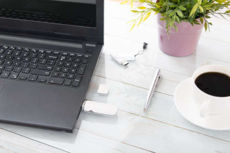 plugged in: White GSM modem plugged in a laptop Stock Photo