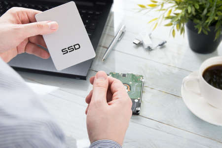 Man is holding modern SSD disk Stockfoto