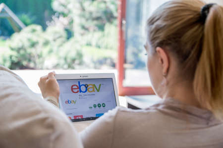 ebay: WROCLAW, POLAND- APRIL 10th, 2017:  Woman is installing ebay application on Lenovo tablet. eBay is a multinational e-commerce corporation, facilitating online C2C and B2B sales.