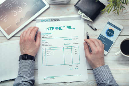 paying: Internet bill  invoice on the white table. Stock Photo