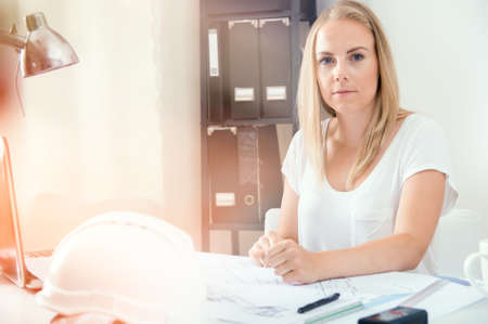 Architect is working with her new project at home office Stock Photo