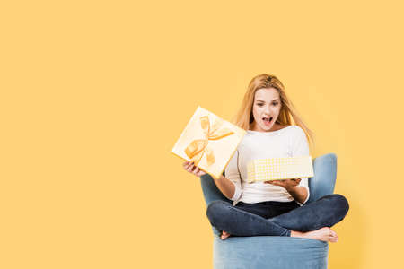 Young woman opens a gift box. Picture includes copy space Stock Photo