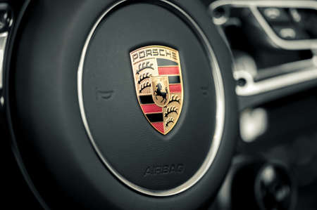WROCLAW, POLAND -  AUGUST 19th, 2017: Emblem of Porsche on steering wheel. Porsche is a German automobile manufacturer specializing in high-performance sports cars