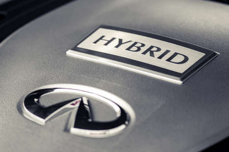 WROCLAW, POLAND -  AUGUST 19th, 2017: hybrid sign on front of infinity engine. Infiniti is the luxury vehicle division of Japanese automaker Nissan