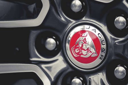 WROCLAW, POLAND -  AUGUST 19th, 2017: Wheels and emblem of a Jaguar sports car. Jaguar is the luxury vehicle brand of Jaguar Land Rover