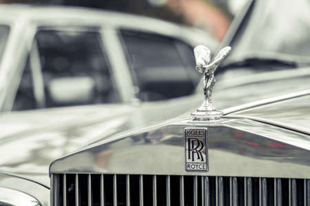 WROCLAW, POLAND -  AUGUST 19th, 2017: Hood ornament on a vintage Rolls Royce car. Rolls-Royce is a British luxury car and aero engine manufacturing business founded in 1904 Editorial