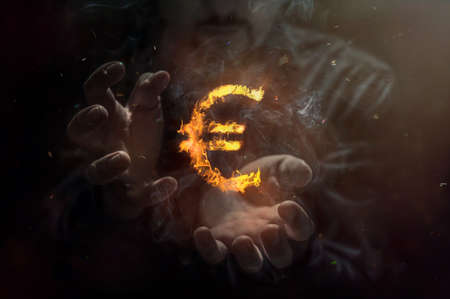 Burning symbol of euro with man in the background. Conception of risk management in money trading at currency market