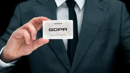 Civil servant shows card with GDPR sign. Conception of personal data protection Stockfoto - 102202017