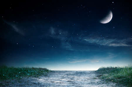 Magic landscape with road and grass over night sky.