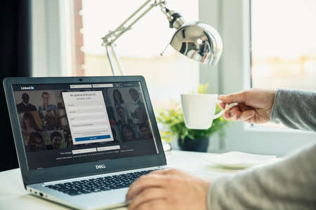 WROCLAW, POLAND - NOVEMBER 29th, 2018: Modern laptop on the desk in office with Linkedin website on the screen. LinkedIn is a business and employment-oriented service that operates via websites and mobile apps Editorial