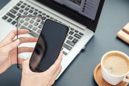 Womans hands hold smartphone and its silicone case