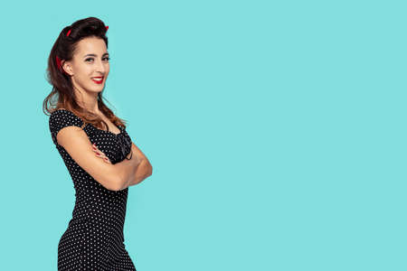 Young pin-up woman with smile on her face and arms crossed. Picture including copy space for text Фото со стока