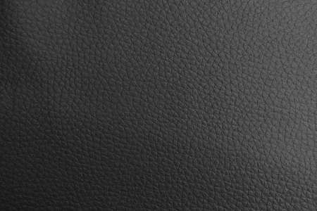 Abstract background of smooth black leather fabric.