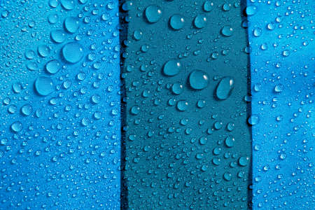 Abstract background of blue hydrophobic fabrics with water drops