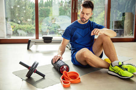 Young man getting ready to do exercises at home