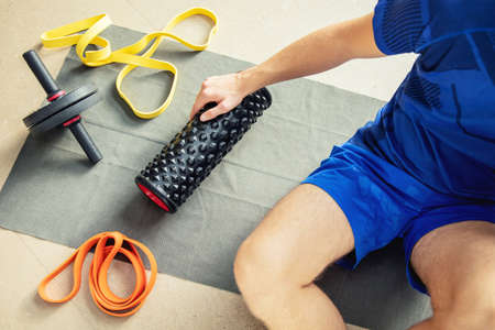 Top view of young man's arm holding exercise machine Stock Photo
