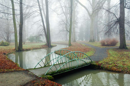 Small garden bridge over a rivulet in the chateau gardens in Kromeriz, Czech Republic.