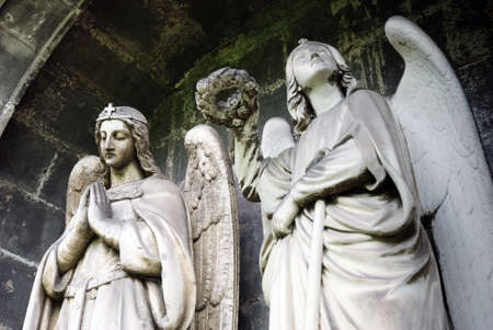 Stone statues of two angels.