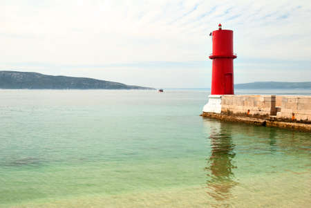 Small Red Lighthouse on the island of Cres photo