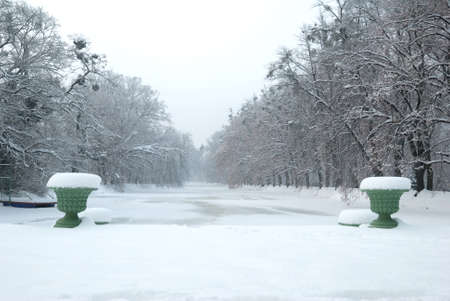 Historic Vases and a Frozen Pond under Snow