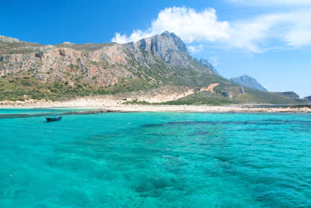 Beach under a Mountain and a Blue Sea View photo