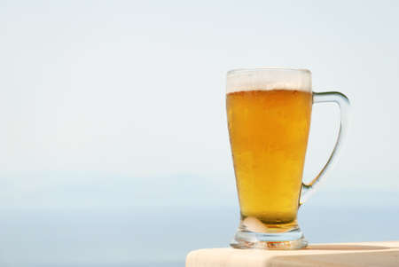 Glass mug of cold beer Stock Photo
