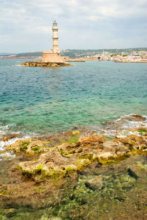 Historic lighthouse and sea in Chania harbor in Crete, Greece.