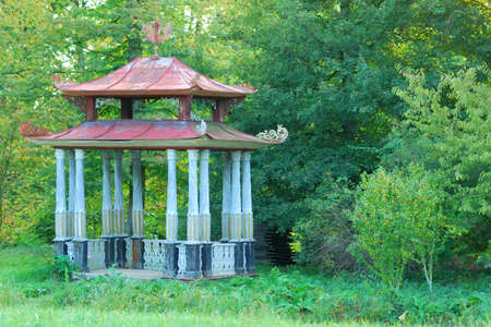 Small Chinese Arbour in a green forest park photo