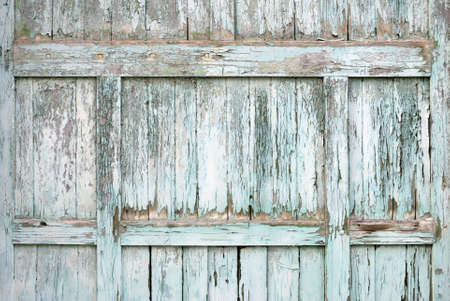 Paint-peeling wooden old door texture detail photo