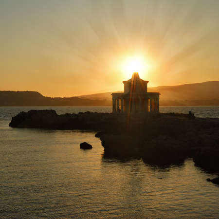 kefallinia: Sunset over Argostoli Lighthouse on Cephalonia Island Stock Photo