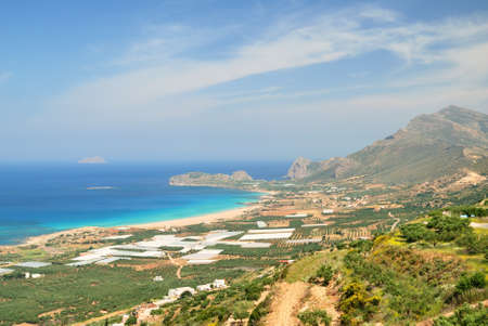 Mountain above a sandy beach and blue sea on Crete photo