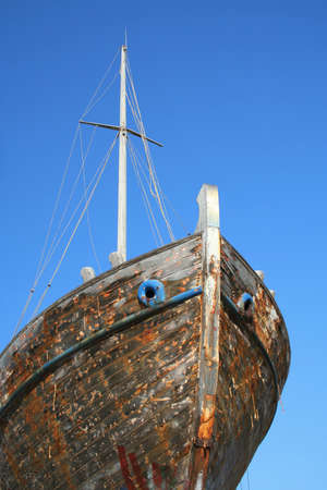 Old flaky ship and blue sky photo